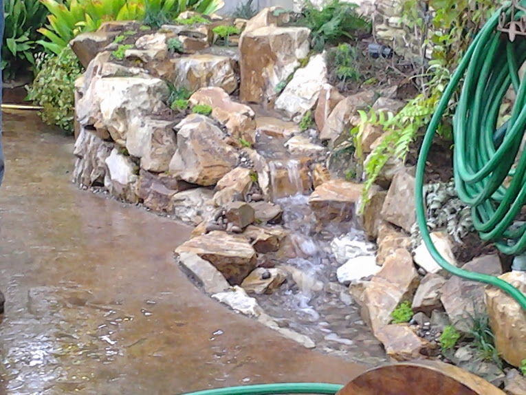 A small yard can have a waterfall pondman for Tiered pond waterfall